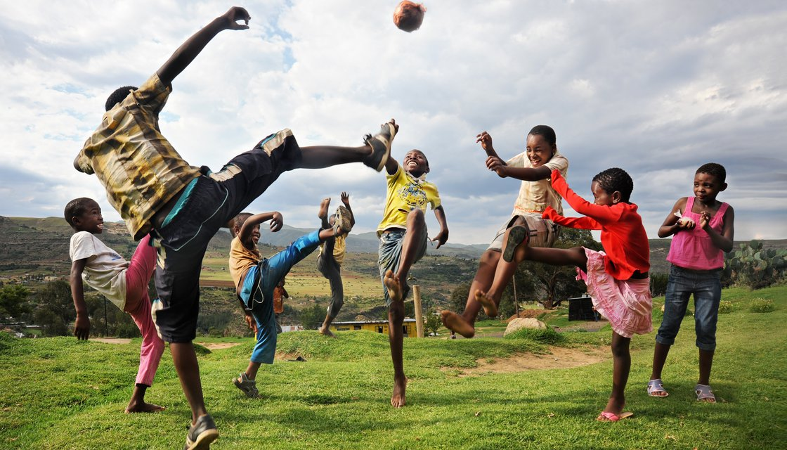 2015 Annual Report cover shot by David Lazar - Lesotho Games (high res).jpg
